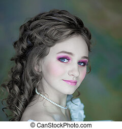 Little girl with beautiful makeup. Little girl in a vintage dress. portrait of a little princess