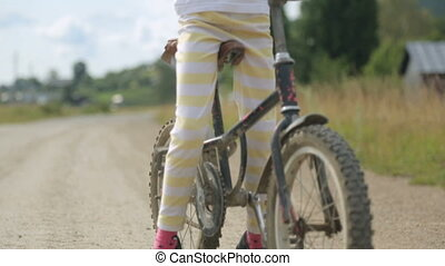 Little girl with bicycle