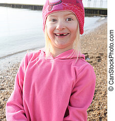little girl with big gappy smile as two front teeth missing