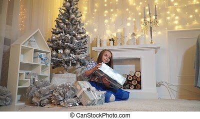 Little girl with big gift box