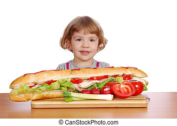 little girl with big sandwich