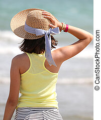 little girl with big straw hat