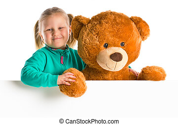little girl with big teddy bear