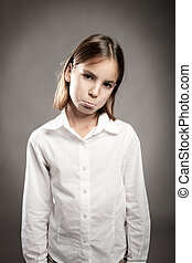little girl with bored expression