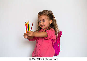 Little girl with bows going to school