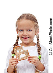Little girl with bread slice