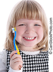 Little girl with brushes for teeth isolated on white