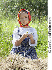 Little girl with camomile flowers