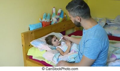 Little girl with chickenpox, father holding thermometer in her mouth