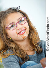 Little girl with chocolate around her mouth