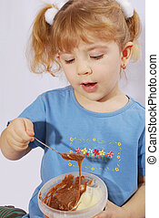 little girl with chocolate cream