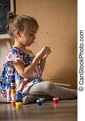 little girl with colored inks