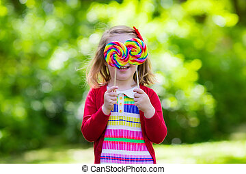 Little girl with colorful candy lollipop - Cute little girl ...