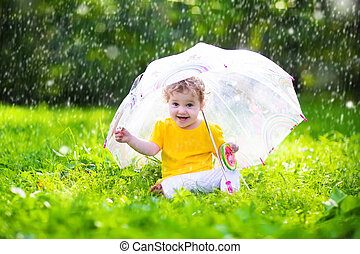 Little girl with colorful umbrella