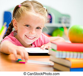 little girl with colorfull pens