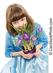 little girl with crocus spring flower - little smiling girl...