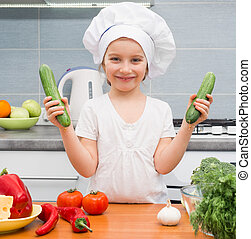 little girl with cucumbers