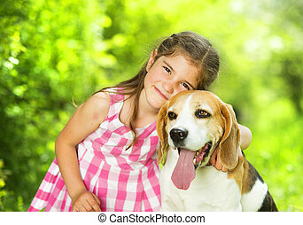 Little girl with dog - Cute little girl is playing with her ...