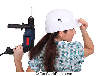 Little girl with drill
