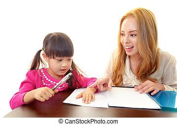 Little girl with English teacher