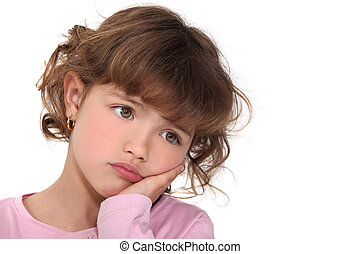 Little girl with expression of sadness