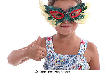 Little girl with feather mask