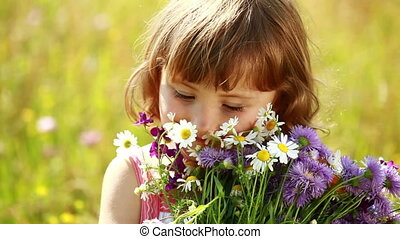 Little girl with flowers laughing