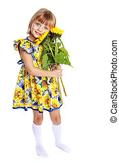 Little girl with flowers of sunflower.