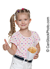 Little girl with fries holds his thumbs up