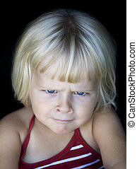Little girl with funny angry face