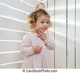 little girl with funny hairstyle in studio