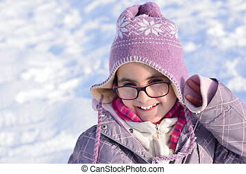 Little girl with glasses posing in