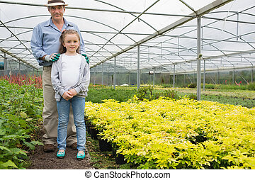 Little girl with grandfather in greenhouse - Little girl...