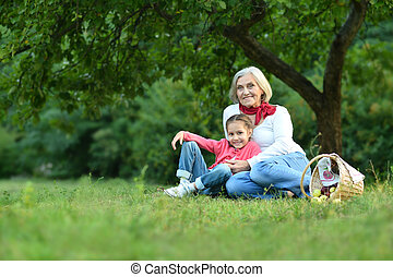 Little  girl with grandmother  in  park