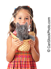 Little girl with gray kitty in wicker, isolated on white