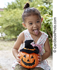 Little girl with halloween pumpkin