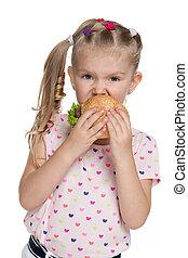 Little girl with hamburger
