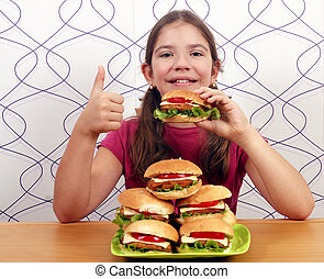 little girl with hamburgers and thumb up