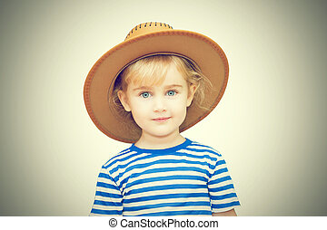 Little girl with hat on