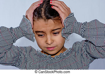 Little girl with headache isolated