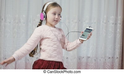 little girl with headphones