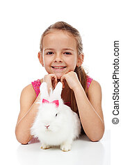 Little girl with her adorable white rabbit