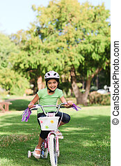 Little girl with her bike