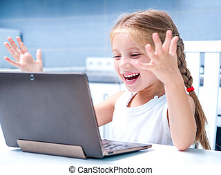 little girl with her computer