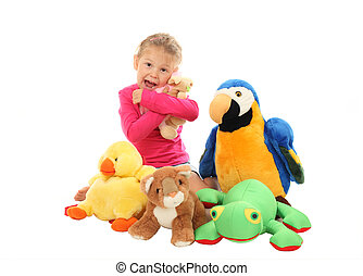 Little girl with her favourite stuffed animals