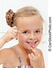 Little girl with her first missing milk tooth - Happy little...