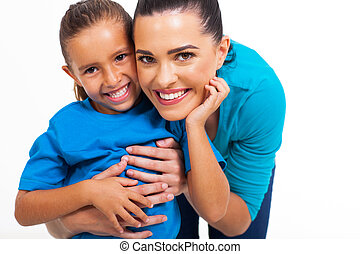 little girl with her loving mother