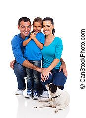 little girl with her parents and their pet dog