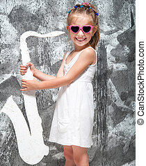 little girl  with her saxophone