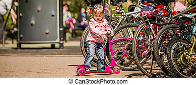little girl with her scooter
